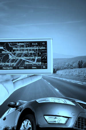 GPS Vehicle navigation system in a man hand. More of this serioes on my portfolio!