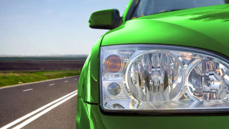 car dealer: Green car on the road Stock Photo