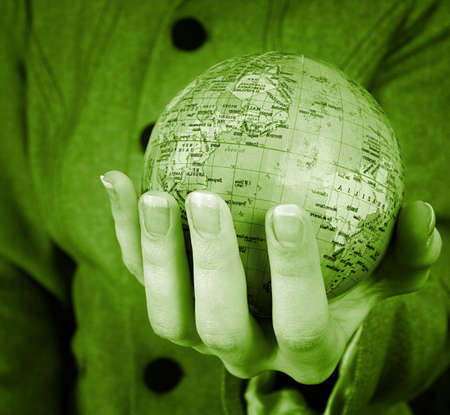 Globe in a girl's hands. Macro image Stock Photo - 3957656