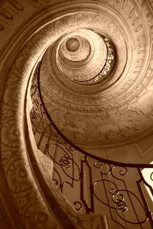 spiral stairway: Very old spiral stairway case Stock Photo