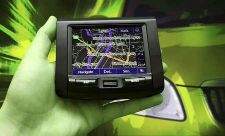 locating: Navigation system in a man hand Stock Photo