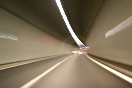 road tunnel: Car lights trails in a tunnel