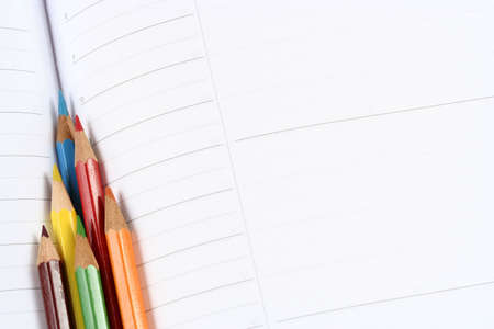 Close-up of color pencils and agenda photo