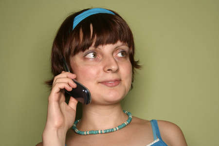 young woman calling by cellular phone. Isolated over green Stock Photo - 5226845