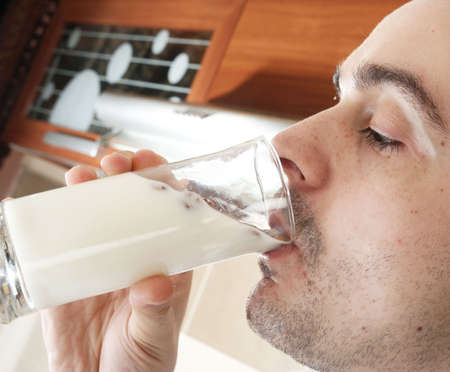 Teenage drinks milk Stock Photo - 5229172