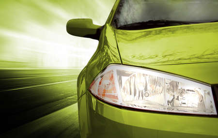 fast cars: Green Sport Car - Front side - on the road.