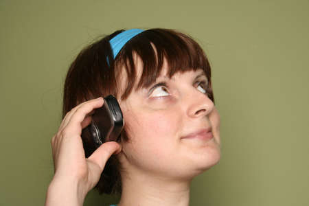 young woman calling by cellular phone. Isolated over green Stock Photo - 5371859