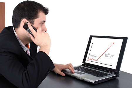 succesful: Succesful business man working at laptop and talking at cellphone