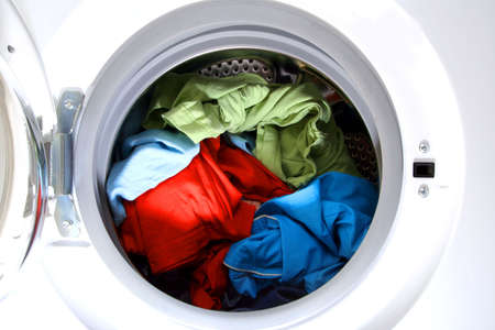 Colorful shirt and trousers in a white laundry. photo