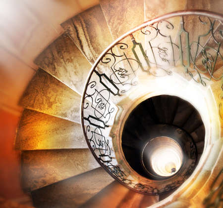 Very old spiral stairway case photo