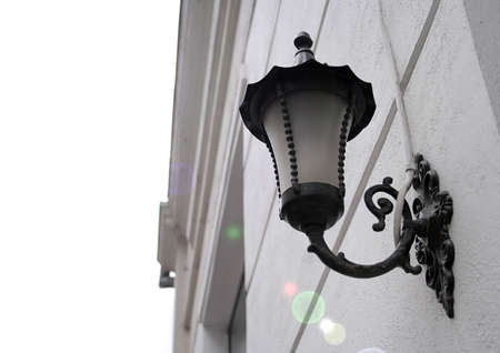 Old traditional wall mount street lamp. photo