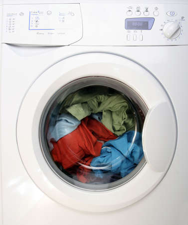 automate: Colorful shirt and trousers in a white laundry.