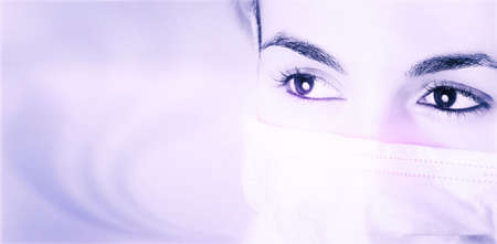 surgeron: Close-up of female doctor with mask .