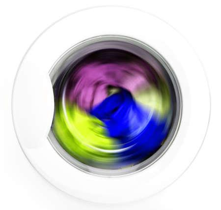 세탁기: Colorful shirt and trousers in a white laundry.