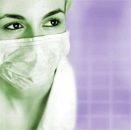 surgeron: Female doctor with mask isolated on blue.