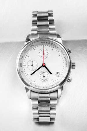 tachymeter: Beautiful Man watch with white background. Stock Photo