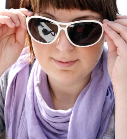 glases: Close-up of  womans face with sunglases. Stock Photo