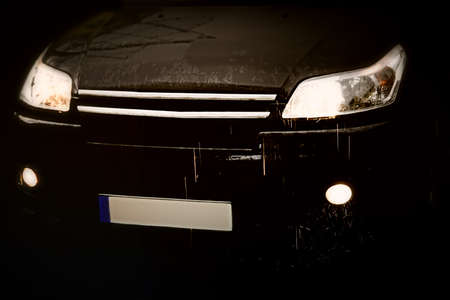Black car in rain -front detail. Stock Photo - 7257607