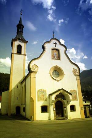 Old catolic church in a quiet mountain town photo