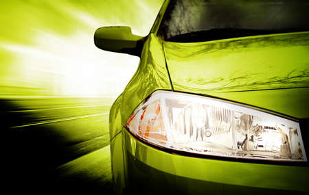 Green Sport Car - Front side - on the road.