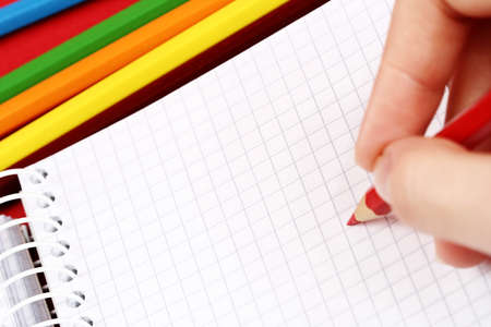 Close-up of pencil and agenda Stock Photo