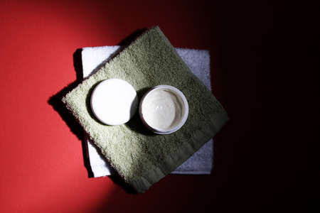Moisturizing cream isolated on red Stock Photo - 7869536