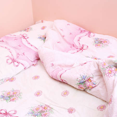 Double bedroom with pink messy sheet . Stock Photo - 7869731