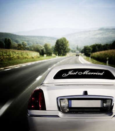 White limo on the road to happiness photo