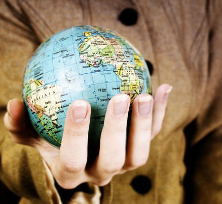 Globe in a girl's hands. Macro image Stock Photo - 8002809
