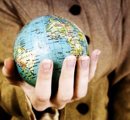 Globe in a girl's hands. Macro image Stock Photo - 8002809