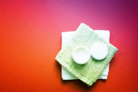 Moisturizing cream isolated on red Stock Photo - 8003344