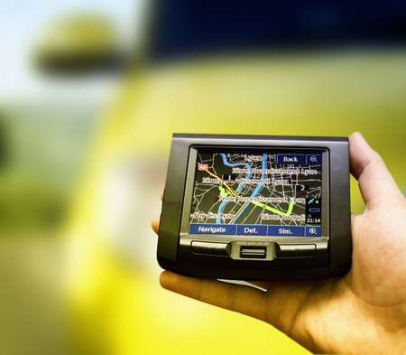 Gps in a man hand. Find your way ! Stock Photo
