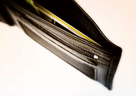 billfold: Black leather wallet isolated on white