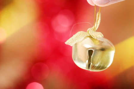 ringer: Close-up of yellow christmas ringer. Stock Photo