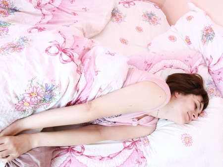Young beautiful woman waking up in the morning . Stock Photo - 8344610