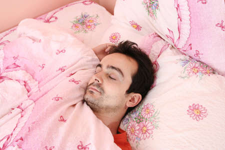Closeup portrait of a young man sleeping on the bed . Stock Photo - 8345069