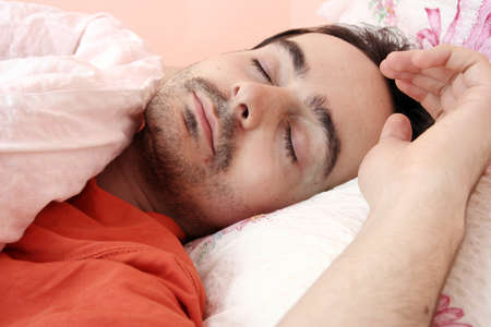 Closeup portrait of a young man sleeping on the bed . Stock Photo - 8345063