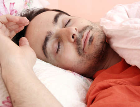 Closeup portrait of a young man sleeping on the bed . Stock Photo - 8432637