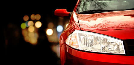 Red car in traffic at night Stock Photo - 8708113