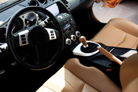 steering: Modern sport car interior: brown wood and leather   Stock Photo