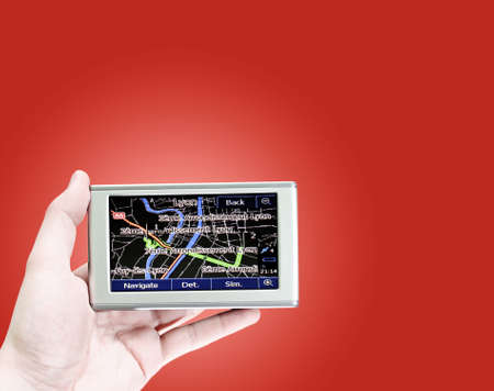 Gps in a man hand. Find your way ! Stock Photo - 8714600