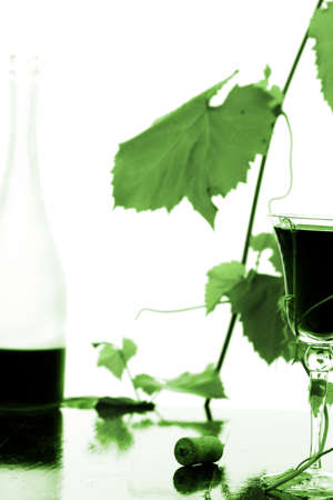 red wine glass and bottle isolated on white Stock Photo - 8974583