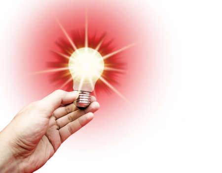 Background with lit lightbulb in a man hand Stock Photo - 9233956