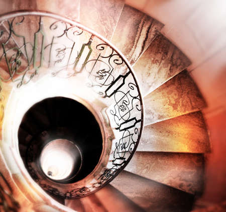 stone stairs: Very old spiral stairway case Stock Photo
