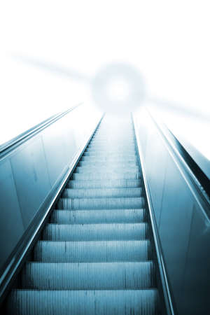 Escalator in the airport going up. photo