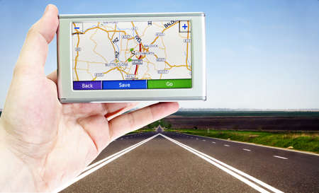 GPS VEHICLE NAVIGATION SYSTEM IN A MAN HAND Stock Photo