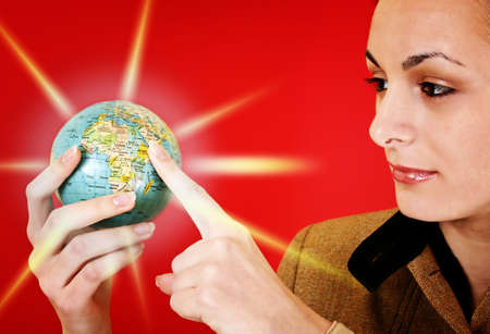 Globe in a girl's hands. Isolated on red Stock Photo - 12467044