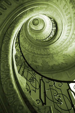Very old spiral stairway case Stock Photo
