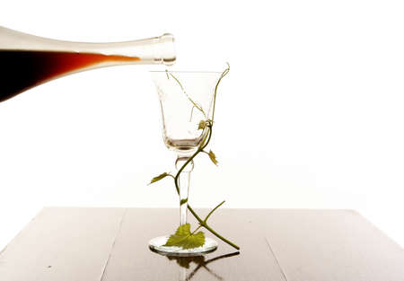 Red wine pouring down from a wine bottle   photo