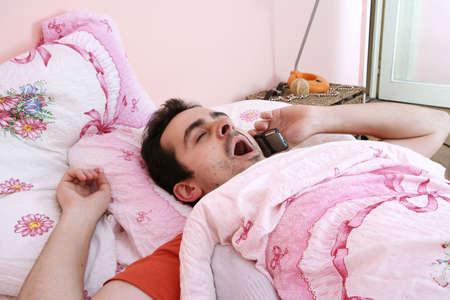 man waking up and turning off alarm. photo